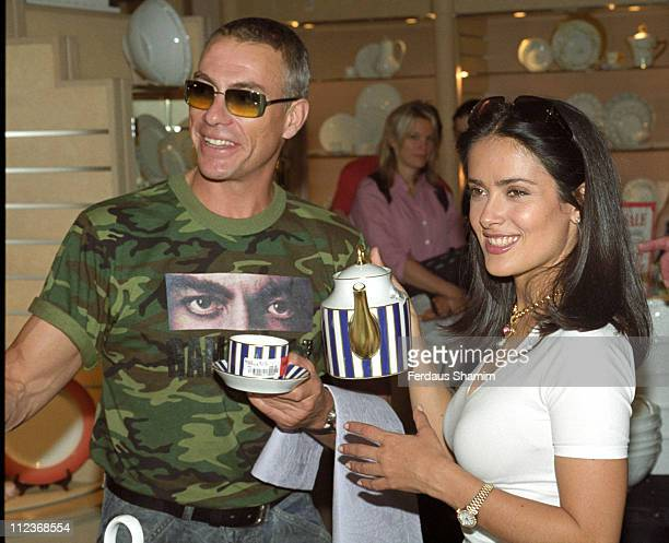 Salma Hayek and JeanClaude Van Damme during Salma Hayek opens Harrods Sale at Harrods London in London Great Britain