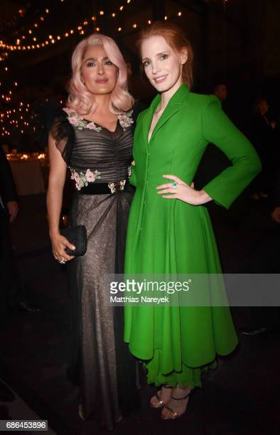Salma Hayek and Jessica Chastain attend the Women in Motion Awards Dinner at the 70th Cannes Film Festival at Place de la Castre on May 21 2017 in...