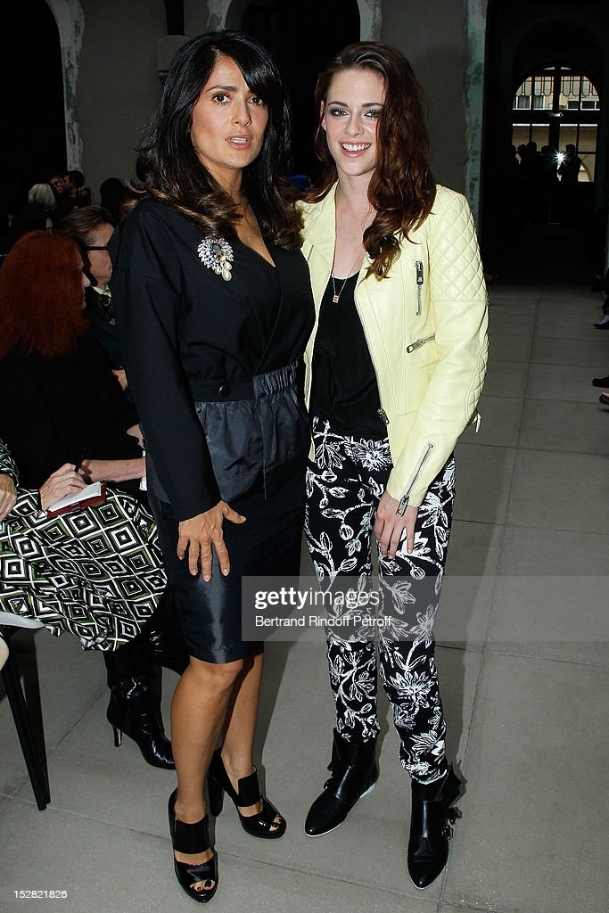 Salma Hayek and Kristen Stewart attend the Balenciaga Spring / Summer 2013 show as part of Paris Fashion Week on September 27, 2012 in Paris, France.