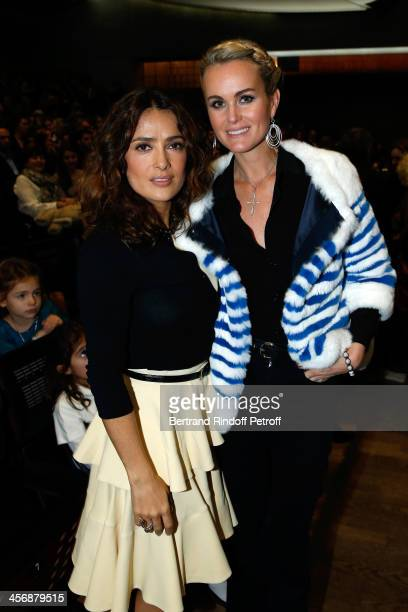 Salma Hayek and Laeticia Hallyday attend the 'Reves d'Enfants' Arop charity event at Opera Bastille on December 15 2013 in Paris France