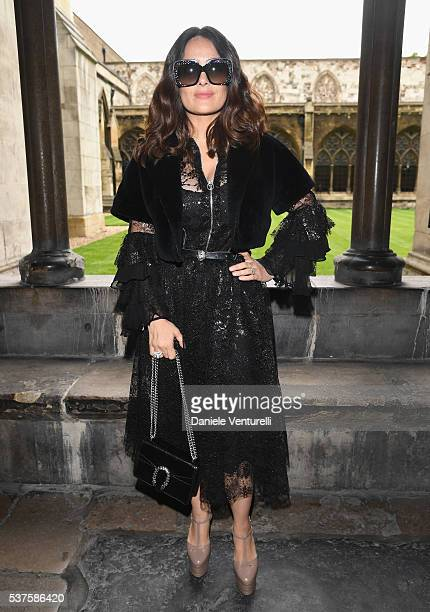Salma Hayek attends the Gucci Cruise 2017 fashion show at the Cloisters of Westminster Abbey on June 2 2016 in London England