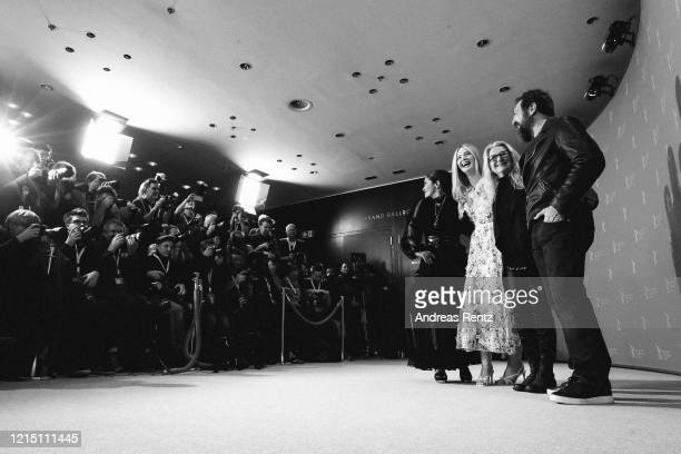 "Salma Hayek, Elle Fanning director Sally Potter and Javier Bardem attend the ""The Roads Not Taken"" photo call during the 70th Berlinale International..."