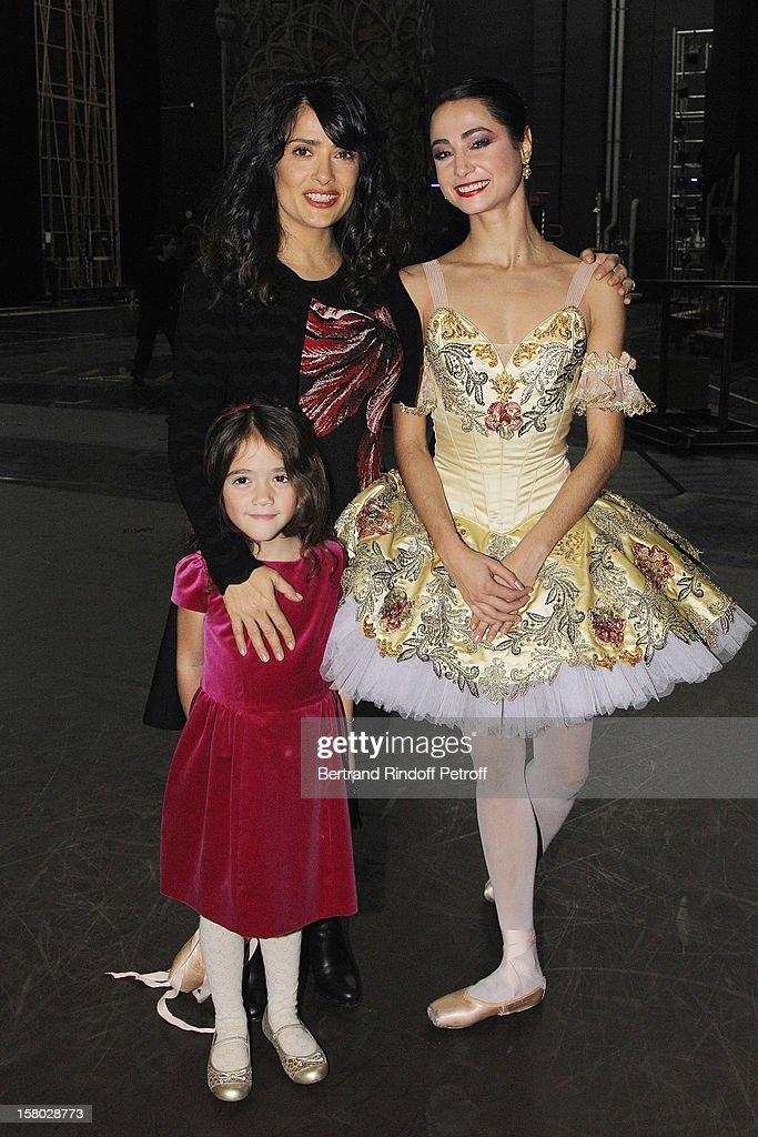 Salma Hayek, her daughter Valentina Paloma Pinault and dancer Mathilde Froustey pose after the Don Quichotte Ballet Hosted By 'Reve d'Enfants' Association and AROP at Opera Bastille on December 9, 2012 in Paris, France.