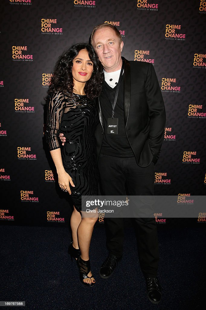 Salma Hayek Pinault and Francois Henri Pinault arrive at the Royal Box photo wall ahead of the 'Chime For Change: The Sound Of Change Live' Concert at Twickenham Stadium on June 1, 2013 in London, England. Chime For Change is a global campaign for girls' and women's empowerment founded by Gucci with a founding committee comprised of Gucci Creative Director Frida Giannini, Salma Hayek Pinault and Beyonce Knowles-Carter.