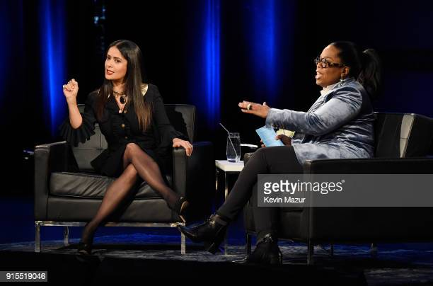 Salma Hayek Pinault and Oprah speak onstage during Oprah's Super Soul Conversations at The Apollo Theater on February 7 2018 in New York City