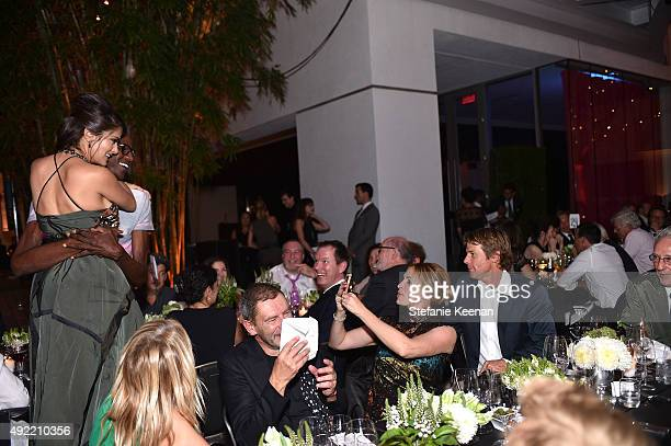 Salma Hayek Pinault, wearing Bottega Veneta, Mark Bradford, Tomas Maier, Julia Roberts, wearing Bottega Veneta and Daniel Moder attend Hammer...