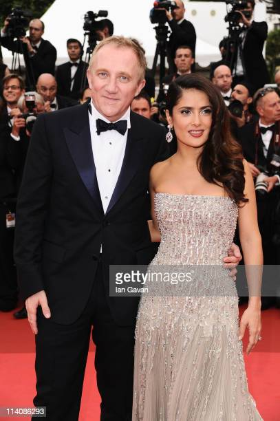 Salma Hayek poses with her husband FrancoisHenri Pinault as they attend the Opening Ceremony at the Palais des Festivals during the 64th Cannes Film...