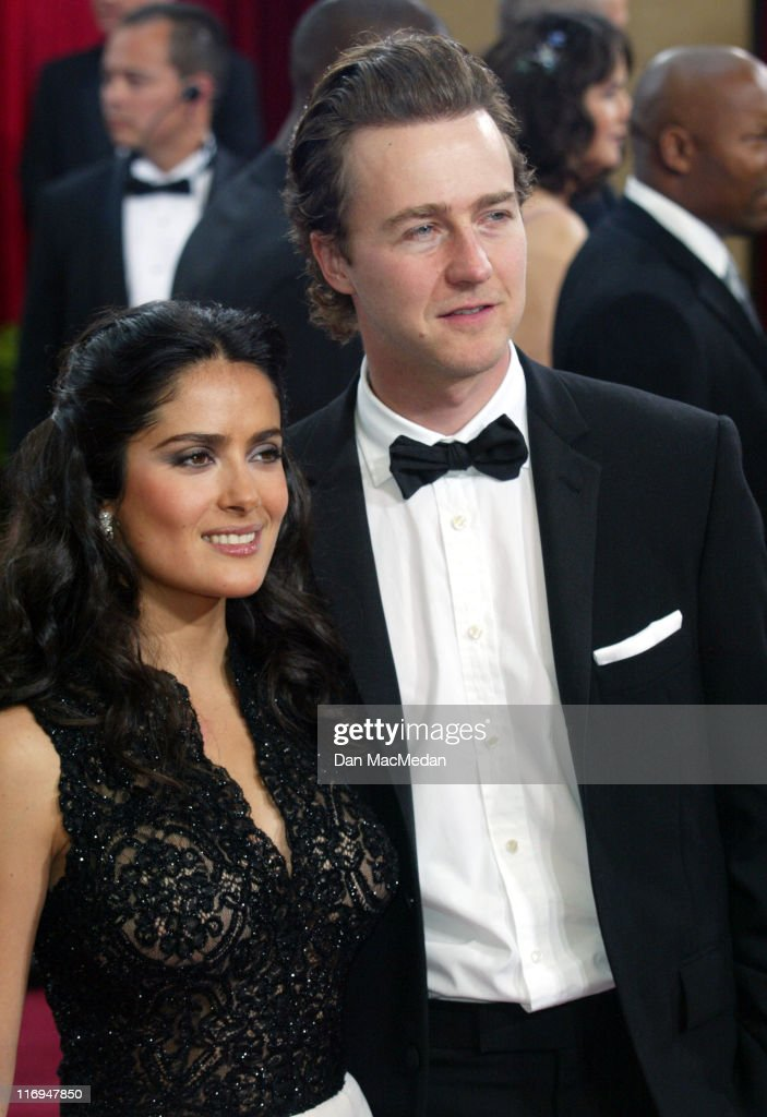 Salma Hayek wearing Harry Winston earrings and Ed Norton