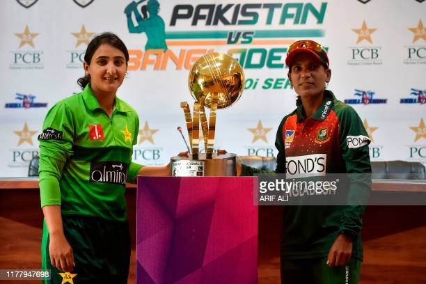 Salma Khatun Bangladesh women cricket team captain and her Pakistani opponentBismah Maroof pose with the T20 series trophy in Lahore on October 24...