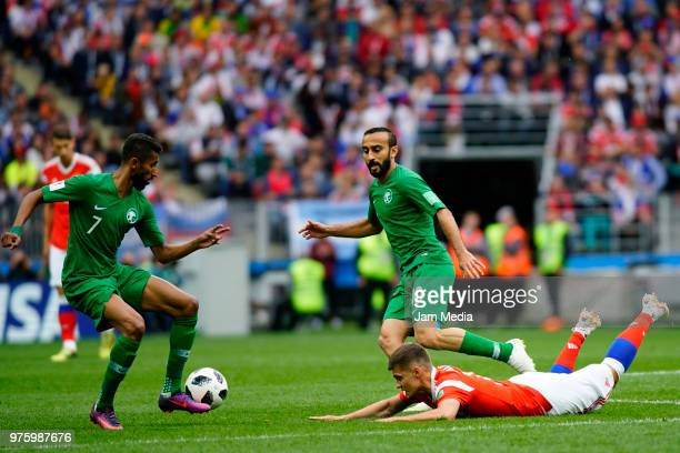 Salman AlFaraj of Saudi Arabia and Mohammed AlSahlawi of Saudi Arabia and Roman Zobnin of Russia during the 2018 FIFA World Cup Russia group A match...