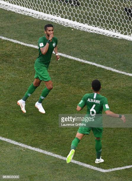 Salman Alfaraj of Saudi Arabia celebrates with teammate Mohammed Alburayk after scoring a penalty for his team's first goal during the 2018 FIFA...