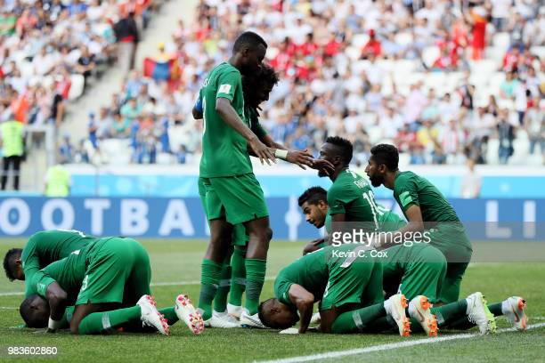 Salman Alfaraj of Saudi Arabia celebrates with teammates after scoring his team's first goal during the 2018 FIFA World Cup Russia group A match...