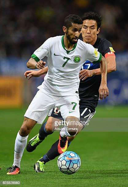 Salman Alfaraj of Saudi Arabia controls the ball under pressure of Makoto Hasebe of Japan during the 2018 FIFA World Cup Qualifier match between...