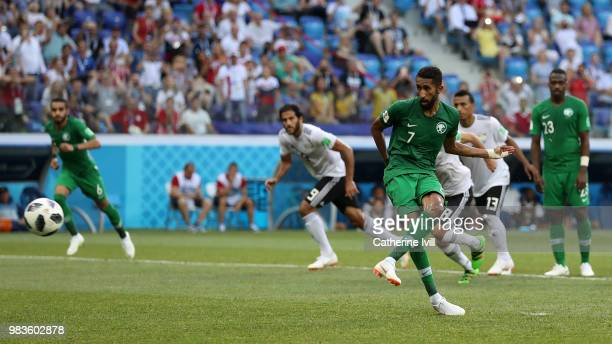 Salman Alfaraj of Saudi Arabia scores a penalty for his team's first goal during the 2018 FIFA World Cup Russia group A match between Saudia Arabia...