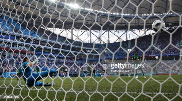 Salman Alfaraj of Saudi Arabia scores a penalty for his team's first goal past Essam El Hadary of Egypt during the 2018 FIFA World Cup Russia group A...