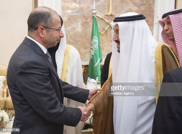 Salman bin Abdulaziz Al Saud King of Saudi Arabia greets Iraq's parliament speaker Salim alJabouri during an organization to exchange Eid alAdha...
