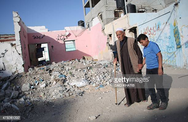 Salman Hamaida a 75yearold Palestinian man who was driven out of the town of Ramla during the 1948 war over Israel's creation walks with his grandson...
