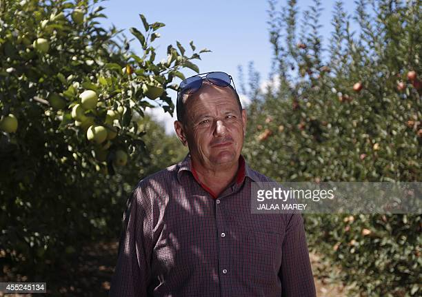 Salman Ibrahim an apple farmer poses for a photo in his orchard on September 7 2014 in the village of Majdal Shams in the Israeli Occupied Golan...