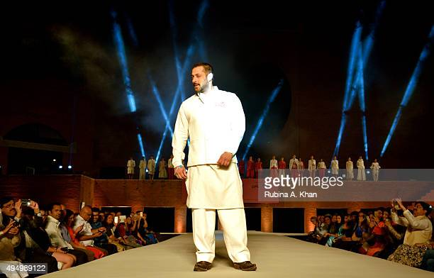 Salman Khan walked the runway in khadi designerwear created by Rohit Bal and Rajesh Pratap Singh at the Fashion Design Council of India's Huts to...