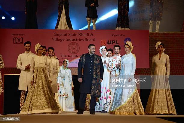 Salman Khan walks in a khadi ensemble by designer Rohit Bal at the Fashion Design Council of India's Huts to High Street - a fashion show organised...