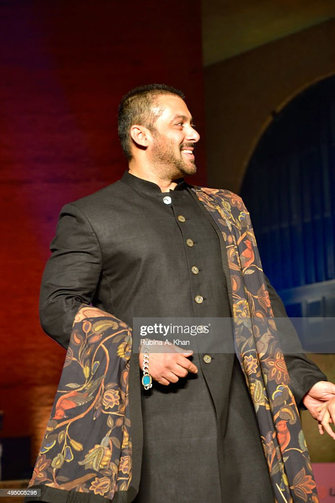 Salman Khan walks the runway in a khadi ensemble by designer Rohit Bal at the Fashion Design Council of India's (FDCI) Huts to High Street - a fashion show organised to promote khadi, alongwith the Gujarat State Khadi & Village Industries Board, where designers Rajesh Pratap Singh, Pero by Aneeth Arora and 11.11 also showcased their designs at IIM Ahmedabad's Louis Kahn Plaza on October 30, 2015 in Ahmedabad, India.