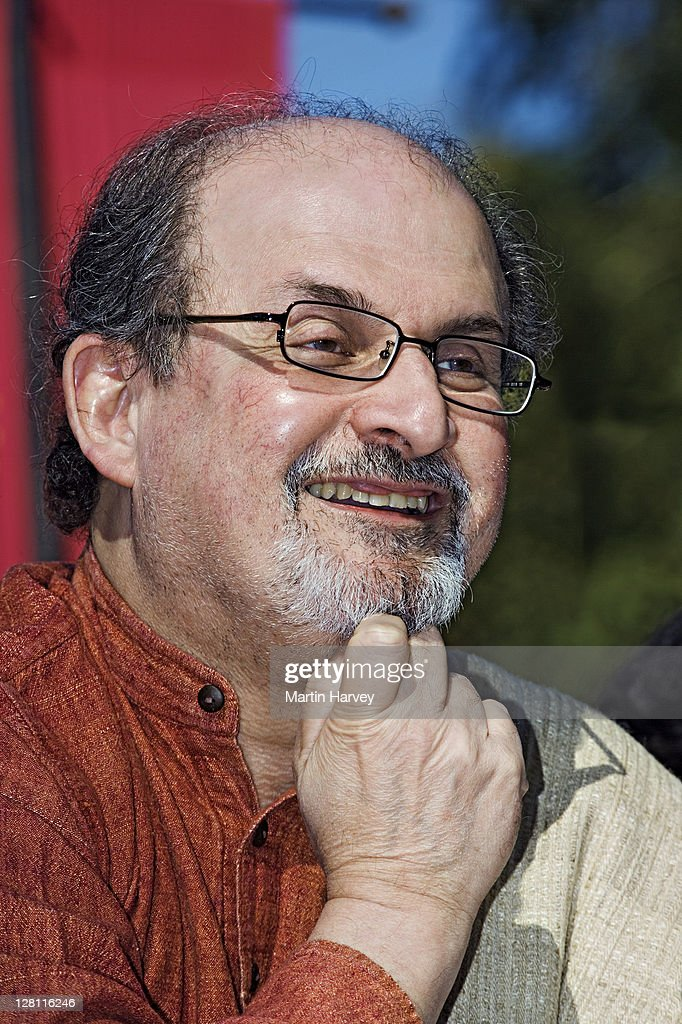 Salman Rushdie. A well-known author native to India, speaking at the Jaipur Heritage International Festival. He is best known for titles like Midnights Children and The Satanic Verses. India. : Stock Photo