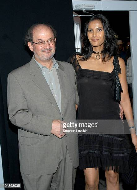 Salman Rushdie and Padma Lakshmi during Mercedes Benz Fashion Week Spring 2004 Baby Phat Arrivals at Bryant Park The Tents in New York City NY United...