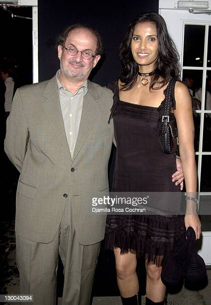 Salman Rushdie and Padma Lakshmi during MercedesBenz Fashion Week Spring 2004 Baby Phat Front Row at Gertrude Tent Bryant Park in New York City New...