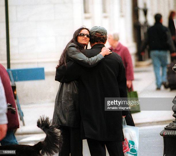 Salman Rushdie and Padma Lakshmi walk along Madison Avenue in New York City New York March 30 2000 Rushdie a celebrated author has spent many years...