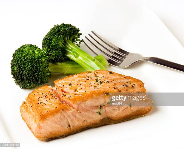 Salmon and brocolli in a white plate
