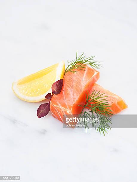 Salmon and lemon on white background