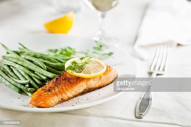 salmon and vegetables - course meal stockfoto's en -beelden