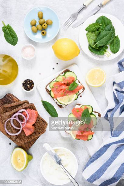 Salmon appetizer sandwiches with cream cheese and cucumber
