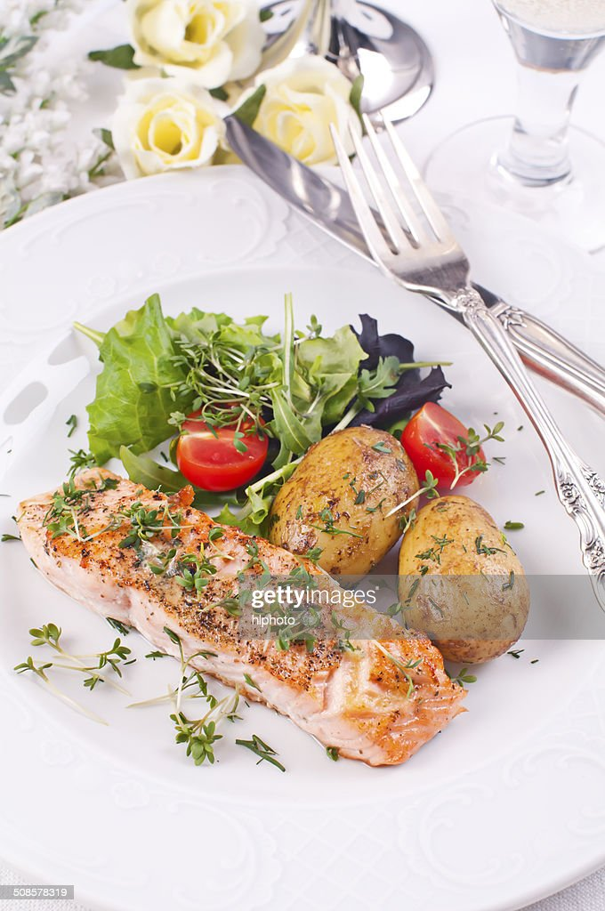 Salmon Filet with Potato and Salad : Stock Photo