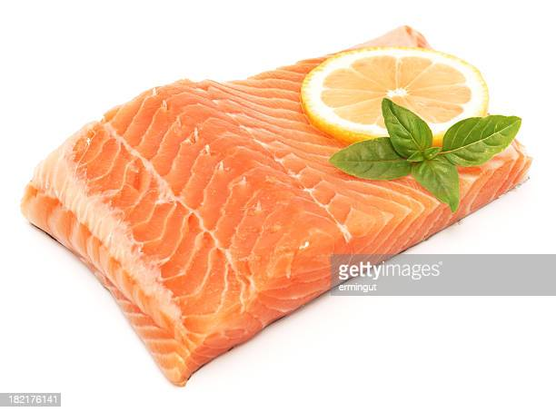 Salmon fillet isolated on white with lemon and herbs