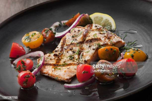 bbq salmon fillet with a tomato and onion salad - gourmet stock pictures, royalty-free photos & images