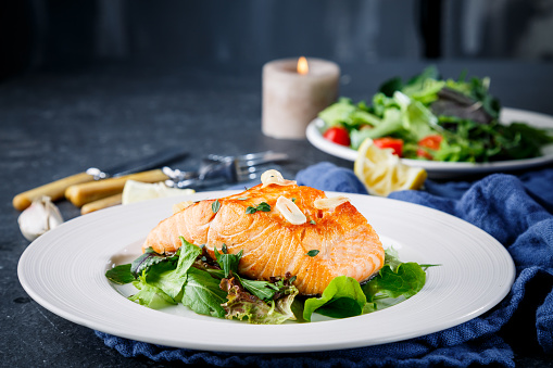 Salmon fish on white plate 503366066