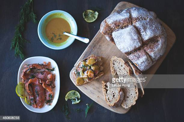 Salmon gravlax on rye bread with mustard sauce