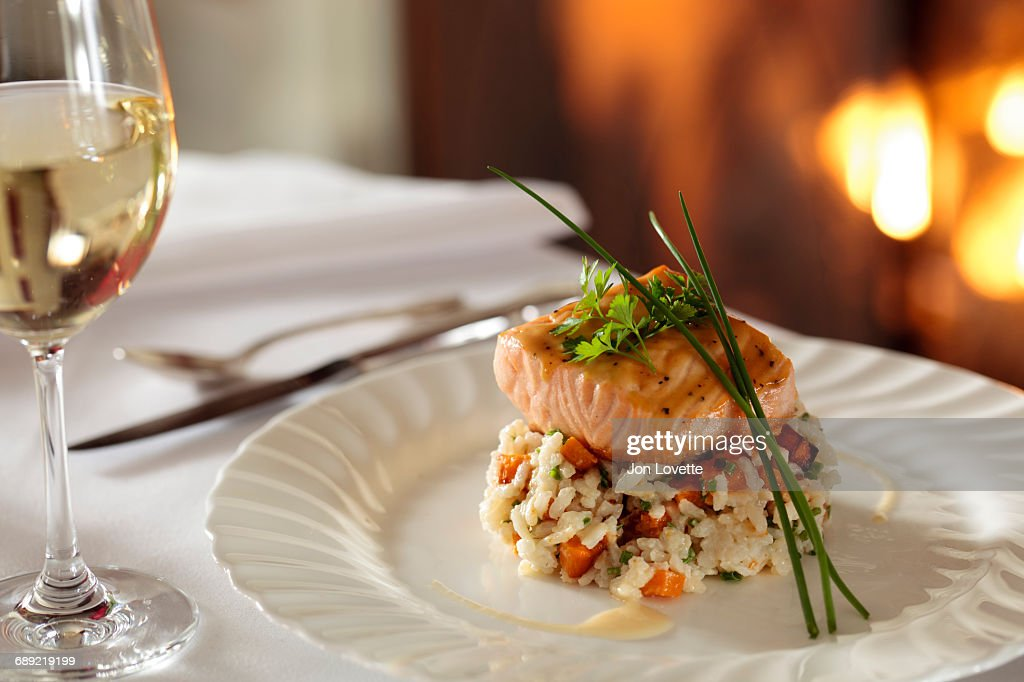 Salmon over rice by fireplace : Stock Photo