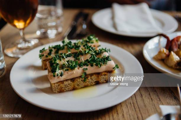 salmon pate with toast in plate on wooden table - french food stock pictures, royalty-free photos & images