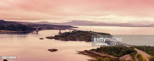 Salmon pink sunset over the Skye Bridge in Scotland