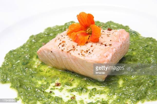 salmon prepared  with salsa verde and nasturtium flower - nasturtium stock pictures, royalty-free photos & images