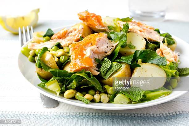 salmon salad on decorated table - prepared potato stock pictures, royalty-free photos & images
