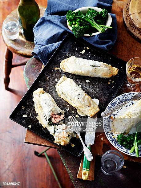 Salmon spinach filo pies, broccolini and wine