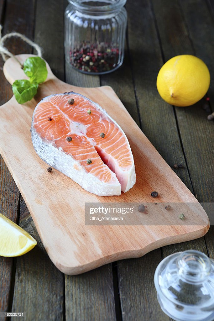 Salmon steak on a cutting board : Stock Photo
