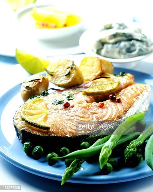 Salmon steak with asparagus, peas & new potatoes