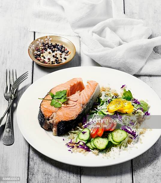 Salmon steak with fresh salad