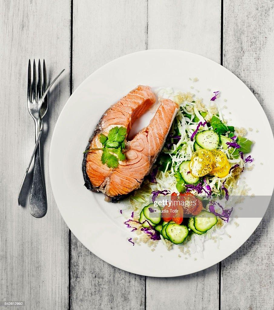 Salmon steak with salad : Stock Photo