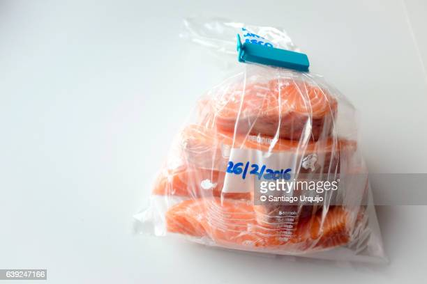 salmon steaks on a freezer bag - airtight stock photos and pictures