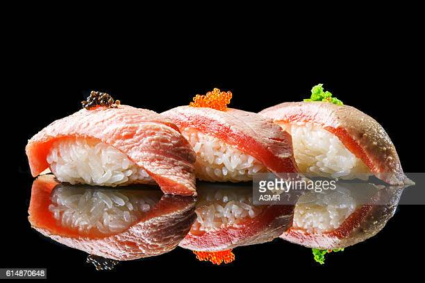 salmon sushi on the blackbackground - nigiri stock pictures, royalty-free photos & images